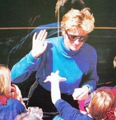 March 24, 1994: Princess Diana with Prince Harry and unidentified companion at lunch on ski holiday in Lech, Austria.