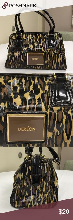 "🌴NEW LISTING🌴 Dereon Satchel Handbag Brown, tan and black. Zipper closure. Inside two open pockets and one zipper pocket. Show signs of use on the inside. Inside is soiled. W 13"" x H 8"" x D 7"". Dereon Bags Satchels"