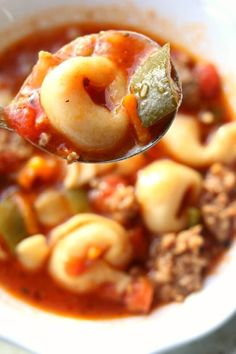 Instant Pot Italian Tortellini Soup--Italian sausage, onions, garlic, tortellini, green peppers, zucchini and tomatoes are simmered for ultmate flavor.
