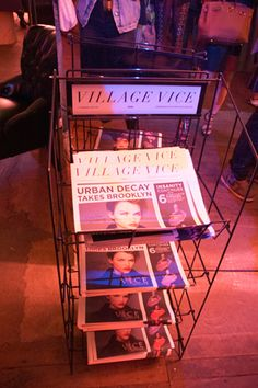 A newspaper rack held Urban Decay's branded riff on the Village Voice, with stories promoting the new makeup collection and star, actress Ruby Rose.