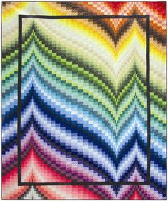 """""""Freckles Frenzy"""" bargello quilt pattern by Patti Carey: create a waterfall of color using a rainbow of textures such as Northcott's Freckles fabric line."""