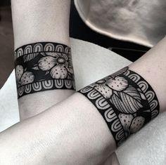 Heavy blackwork bracelets by Dom Wiley