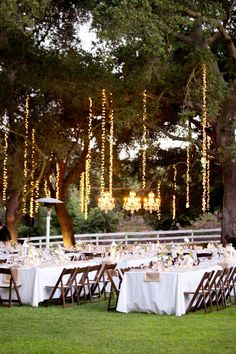 How cool does this string lighting in trees look for this outdoor reception? Photograph, courtesy of Pinterest.