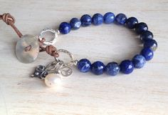 Reminds me of gorgeous blue skies:) Sodalite Beaded Bracelet Greek Leather Toggle Clasp by LoveandLulu, $55.00