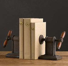 Interesting book ends..not sure what they are..some kind of vintage vice grip? Good looking book ends..