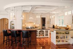 Ceiling details add to the elegance of the kitchen. Dodd Woodworking - Custom Millwork - Mendon, MA   Boston Design Guide