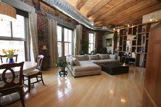 Faux wood floors, brick wall, exposed ceiling