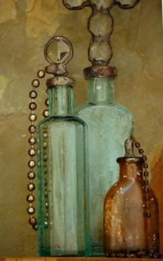 Steampunk-1940's Vintage Pharmacy Bottle with Silver Solder, Antique Crystal & Crystal Quartz. $47.00, via Etsy.