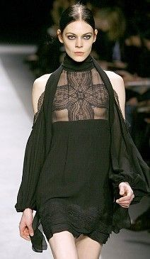 Designer work inspired by 1990s: This Versace dress is inspired from the 90's because of the use of black and goth influences.
