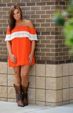 orange off the shoulder shift dress and cowboy boots