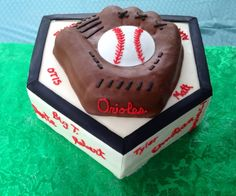 Widefield Orioles Baseball 2013 Home Plate- Vanilla Cake with Chocolate Mousse Filling, Buttercream Frosting covered in Buttercream Fondant Baseball Glove- Chocolate Cake with Chocolate Mousse Filling, Buttercream Frosting covered in Chocolate Buttercream Fondant Team Names & Coaches Names- Red Buttercream Frosting