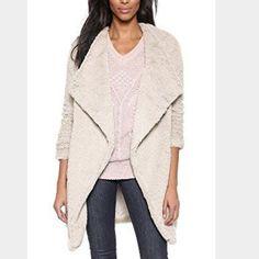 BB Dakota fur coat Sheep BB Dakota Faux-fur coat with asymmetric single-button front closure Pockets at sides 31-inch length BB Dakota Jackets & Coats