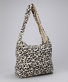 Made of repurposed materials and eco-friendly fabric, this chic leopard print reusable bag seamlessly mixes high fashion with an everyday carryall that's perfect for the grocery store, travel, yoga, a laptop and more. Stash all the necessities and then some in this fabulous tote. 22'' W x 34'' H x 6'' D