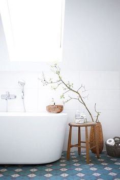 blue tile floor in white bathroom