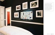 TV camouflaged among framed art