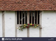 Autumn flower decoration on a medieval timber framed house window at Stock Photo, Royalty Free Image: 163931419 - Alamy