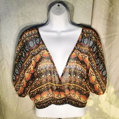 Forever 21 Boho-style Shrug  Sheer, lightweight cover up with lotus flower pattern. Has 2 sets of snaps at bottom to adjust size of waist. Forever 21 Tops