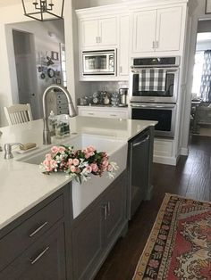 White and gray kitchen with an antiqued runner.