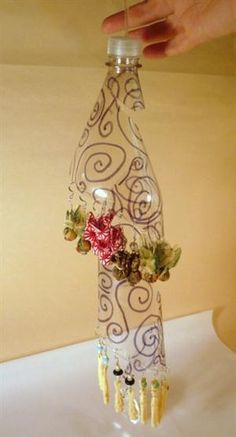 Make a Recycled Soda Bottle Earring Display...I think this is so pretty!!!(DS)