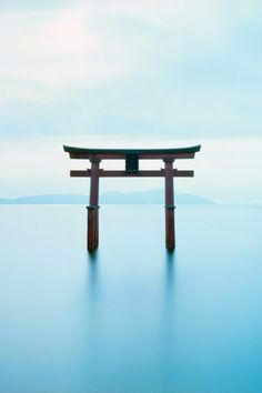 """This is a torii, """"a Japanese gateway of light construction commonly built at the approach to a Shinto shrine"""" (definition http://www.merriam-webster.com/dictionary/torii) Original image: http://www.flickr.com/photos/tyarahan/6695418777"""