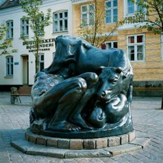 Kai Nielsen's bronze sculpture on the square in Faaborg, Funen, Ymerbrønden (The Well Of Ymer) performed 1912-13 tells the creation story in Norse mythology about the original giant Ymer (Ymir), drinking milk from the cow Audhumblas's udder