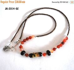 On Sale Brown and Orange Lampwork Bead by polymerclaybeads on Etsy