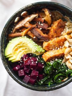 This quinoa shiitake bowl with tempeh and spinach is the perfect make ahead lunch! Top with avocado and a drizzle of sesame oil for healthy fats and fermented veggies for probiotics!