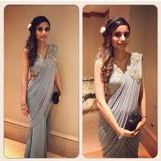 A client wearing a sea blue silk jersey saree drape creation. Shop at our store. Nearest staton: Baker Street. For enquiries call us on 020 7486 Drape Sarees, Saree Draping Styles, Saree Styles, Drape Gowns, Indian Wedding Outfits, Indian Outfits, Bridal Outfits, Wedding Dresses, Saree Gown