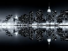 Jonas Gheysen Skyline of #NYC by night reflected on the water