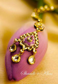 Hair ornament, A Maan tikka with Kundan Polki & gold enamelling. http://www.shaadiekhas.com/blog-wedding-planning-invitation-wordings/shaadi-e-photos/