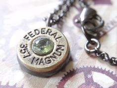 So cool!  357 Magnum Bullet Necklace Bullet Shell Necklace Faceted Peridot.