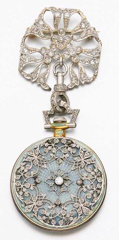 Platinum, gold, diamond and enamel Pendant Watch, Tiffany & Co., ca. 1910, via Sotheby's.