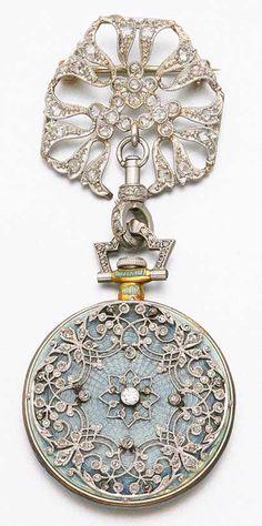 Platinum, gold, diamond and enamel Pendant Watch, Tiffany & Co., ca. 1910, via Sotheby's.