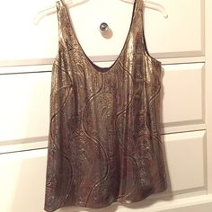 J. Crew metallic tank top 60% silk. Only worn once and dry cleaned immediately after J. Crew Tops Blouses