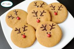 Adorable take on reindeer cookies.  Pipe melted chocolate onto pb cookies for antlers, eyes and to hold nose on.