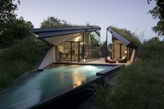 A hidden triangular home built into the earth in Austin, Texas