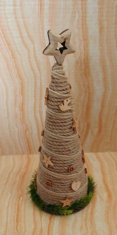 Mini Rustic Tree: This rustic Christmas Tree is made of jute rope wrapped around a Styrofoam cone. Decorated with wooden flowers , hearts, doves and stars. This mini Christmas Tree is 11 long cm) and is perfect for decorat Decoration Christmas, Rustic Christmas, Holiday Decor, White Christmas, Noel Christmas, Crochet Christmas, Cone Christmas Trees, Christmas Ornaments, Cone Trees