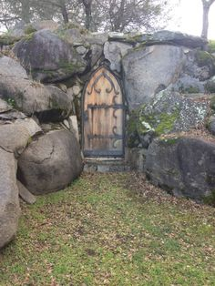 stone and medieval door with iron hinges.  posted to facebook by faerie magazine