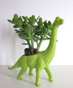 Brachiosaurus Planter & Succulent via oh joy! This is a cool idea to make planters out of old toys. [take a look at kids exchange for simple toys!]