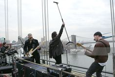 Larry Mullen, Jr., Adam Clayton, Bono and the Edge of U2 spend the day on the streets of New York City shooting a video for their new album 'How to Dismantle an Atomic Bomb' which drops tomorrow, Tuesday, November 23rd. U2 finished off the day in Brooklyn at the Empire-Fulton Ferry State Park where they played songs off of their new album for their fans. MTV captured the show for future broadcast.