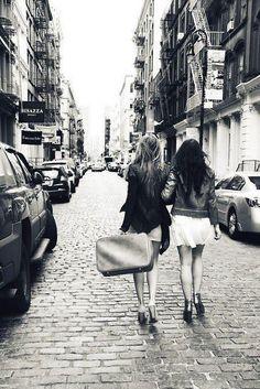 Girlfriends Walking in city street