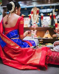 South Indian bride. Gold Indian bridal jewelry.Temple jewelry. Jhumkis.Blue purple and red silk kanchipuram sari.Bun with fresh jasmine flowers. Tamil bride. Telugu bride. Kannada bride. Hindu bride. Malayalee bride.Kerala bride.South Indian wedding.