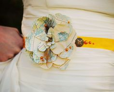 Be Sunny. Yellow satin wedding sash with vintage map flower. $124.00, via Etsy.