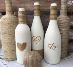Love wine bottle in cream colored chalk paint with gold metallic letters and twi. - Glas , bottle crafts gold Love wine bottle in cream colored chalk paint with gold metallic letters and twi. Alcohol Bottle Crafts, Glass Bottle Crafts, Diy Bottle, Decorative Glass Bottles, Wine Bottle Vases, Painted Wine Bottles, Bottles And Jars, Empty Wine Bottles, Diy Home Crafts