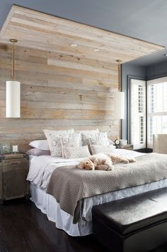 reclaimed wood wall behind a bed could add a rustic touch to any decor