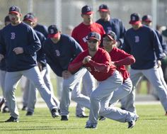 May I have this dance? Dustin Pedroia stretched in front of prospect Jose Iglesias.