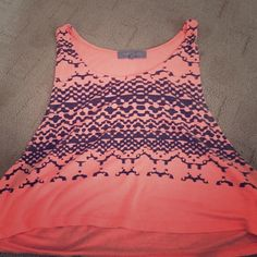 Orange crop top Orange crop top with tribal print, worn, no flaws. Size small. ✅trades✅ comes from smoke free pet free home Huntingbird Tops Crop Tops