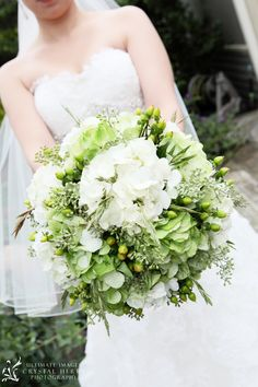 green and white hydrangea with berries,herbs and assorted grass
