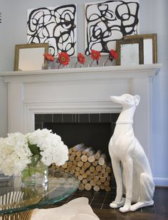 Another white ceramic dog statue - on the fireplace!