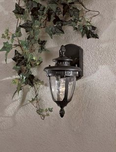 """Burwick Collection 14"""" High Outdoor Light by Minka Lavery. $73.90. The Old World look of this outdoor light imparts a feel of settled-in comfort to its surroundings. Detailing in the fixture creates an air of luxury while the Traditional styling has a familiar beauty. Mouth blown, seeded glass adds to the romantic, historic feel.. Save 36% Off!"""